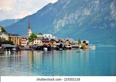 Image of famous alpine village Hallstatt during colorful summer morning.