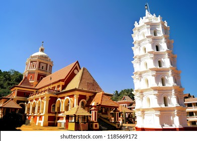 Image of the famous ancient Shantadurga Temple with the DeepSthambha(tower where lamps are lighted in Earthern pots) in the foreground located in the Indian state of Goa
