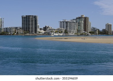 Image features south Maroochy river, sandbar with pelicans and Maroochydore high rise buildings. Image taken from Cotton Tree, Maroochydore, Queensland, Sunshine Coast, Australia.