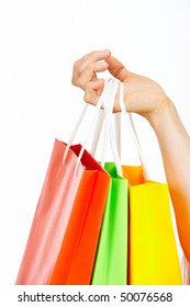 Image of female hand holding multi-colored bags