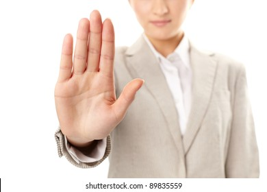 Image of female hand showing sign of stop