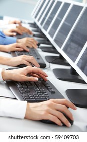 Image of female hand typing in computer classroom