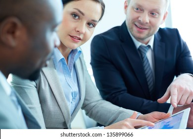 Image of female looking at business partner during discussion at meeting
