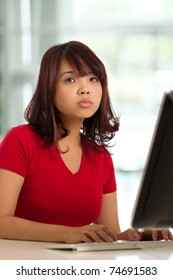 Image of a female working at desk