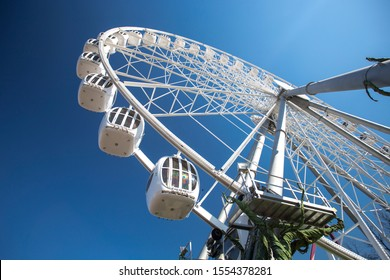 Image of ferris wheel made with wide angle lens with polar filter.