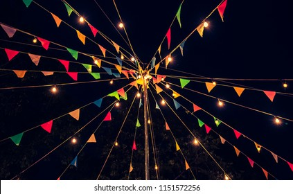 Image of Festival Colorful Flags with Light in Night Time . (vintage tone)
