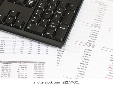 image of financial report with computer keyboard at the office