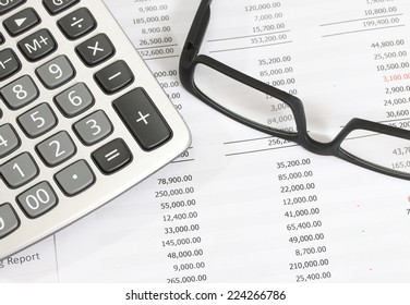 image of financial report with glasses and calculator at the office