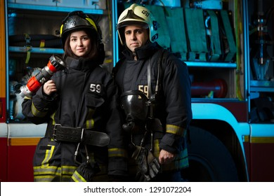Image of fireman and woman near fire truck