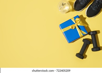 image of fitness equipment and gift box