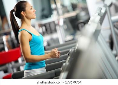 Image of fitness girl running on treadmill