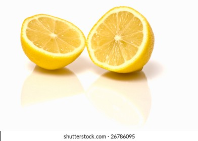 Image of fresh lemon fruit cut in half with reflections. Copy space on the bottom