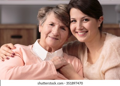Image of friendship between happy carer and senior woman