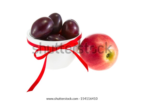 a Image of fruit apples and plums in a bowl