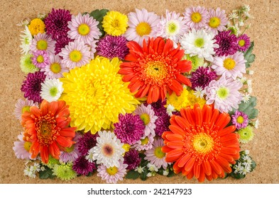 Image of full color flowers on brown cork background