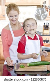 Image of girl eating a slice of bitter melon while her mother is on her back