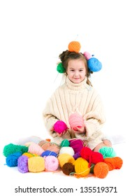 The image of the girl with knitting spokes and balls of threads in hair