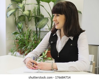 The image of girl in an office