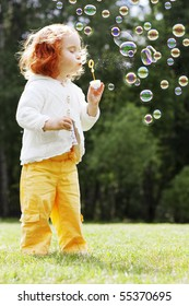 The image of the girl puts the bubbles in the park