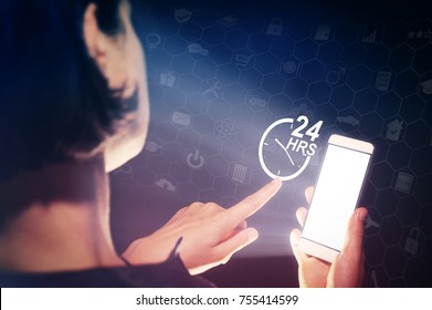 Image of a girl with a smartphone in hands. She presses on the 24-hour support service icon. Concept of 24-hour support.