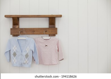 the image of giving birth and baby clothes
