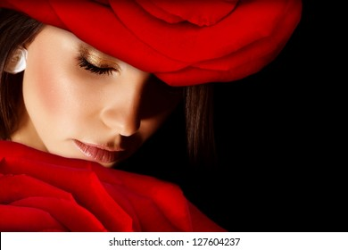 Image of glamorous woman wearing stylish floral hat, closeup portrait of beautiful arabic female with red rose on head isolated on black background, closed eyes, Valentine day, beauty salon