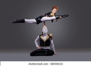 Image of go-go dancers posing in acrobatic pose