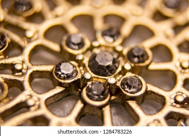 image of gold jewelry close-up in minimal depth of field