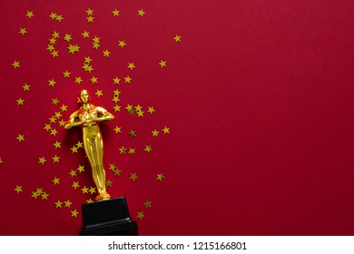 image of gold statue trophy on red background