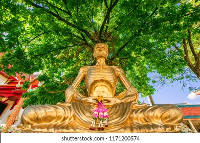 Image of Golden Bhudda statue sitting meditation under tree. The Lord Buddha's searching the way out of suffering with Fasting and enlightenment with Discipline Of the Bhuda.