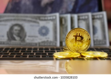 Image of golden bitcoins (cryptocurrency) are on the keyboard blurred background, virtual money or digital currency : Trading and business concept.