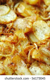 image of golden fried potatoes as background