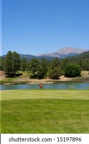An image of a golfer preparing to swing on an Arizona course