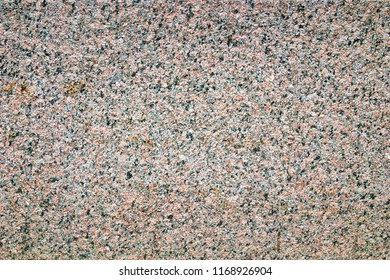 Image of a granite wall as a backdrop.