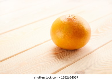 Image of grapefruit on wooden background with copyspace