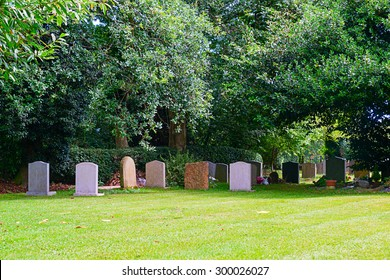Image of gravestones in a peaceful churchyard