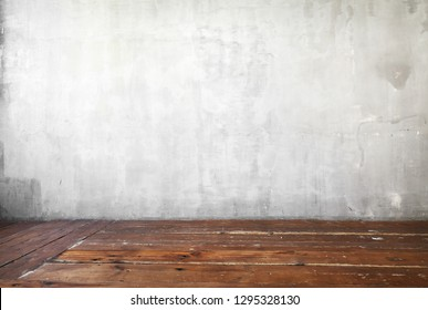 Image of gray concrete wall background and old wooden floor