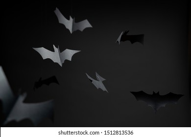 Image of gray paper bats on blank black background.