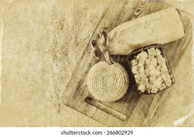image of greek cheese , bulgarian cheese and milk on wooden table over wooden textured background. Symbols of jewish holiday - Shavuot. Black and white style photo