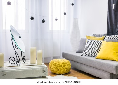 Image of a grey and yellow living room