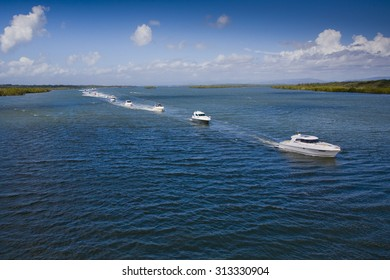Image of a group of small motor boats racing in the sea on a beautiful day