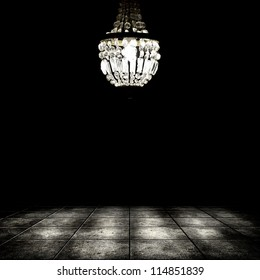 Image of grunge dark room interior with chandelier. Background