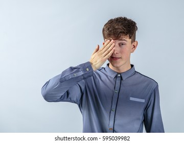 Image of an guy covering eye on a light blue background