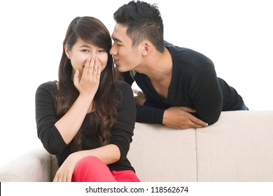 Image of a guy sharing a funny gossip with his girlfriend