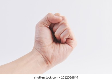 image of hand gesture showing fist symbol on white background