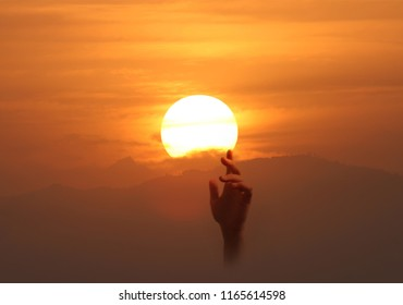 Image of a hand reaching up to the sun. Fulfillment and success concept.