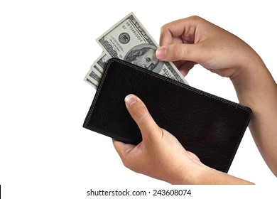Image of a hand taking 100 Dollar bills from leather wallet isolated on white