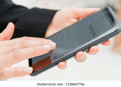 Image of hands entrepreneur using calculator on smart phone about cost at Small business. woman accountant making calculations to count income and outcome. Savings,Business Financing economy Concept.