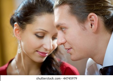 Image of handsome man looking at shy woman
