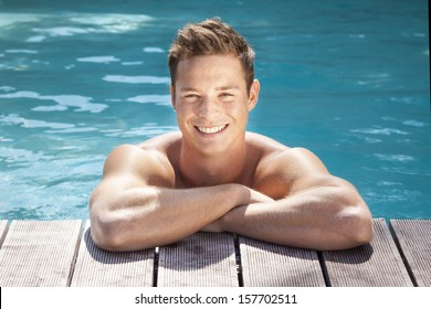 An image of a handsome man in the pool